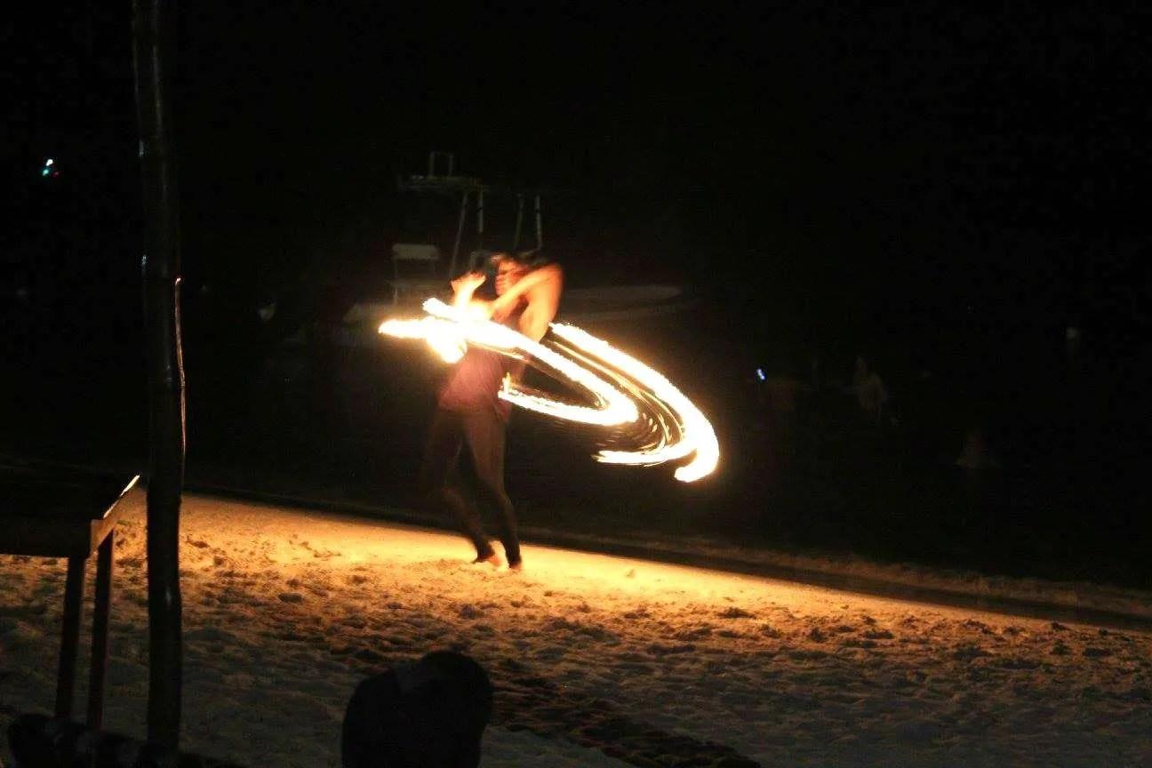 things to do in Roatan watch fire dancers