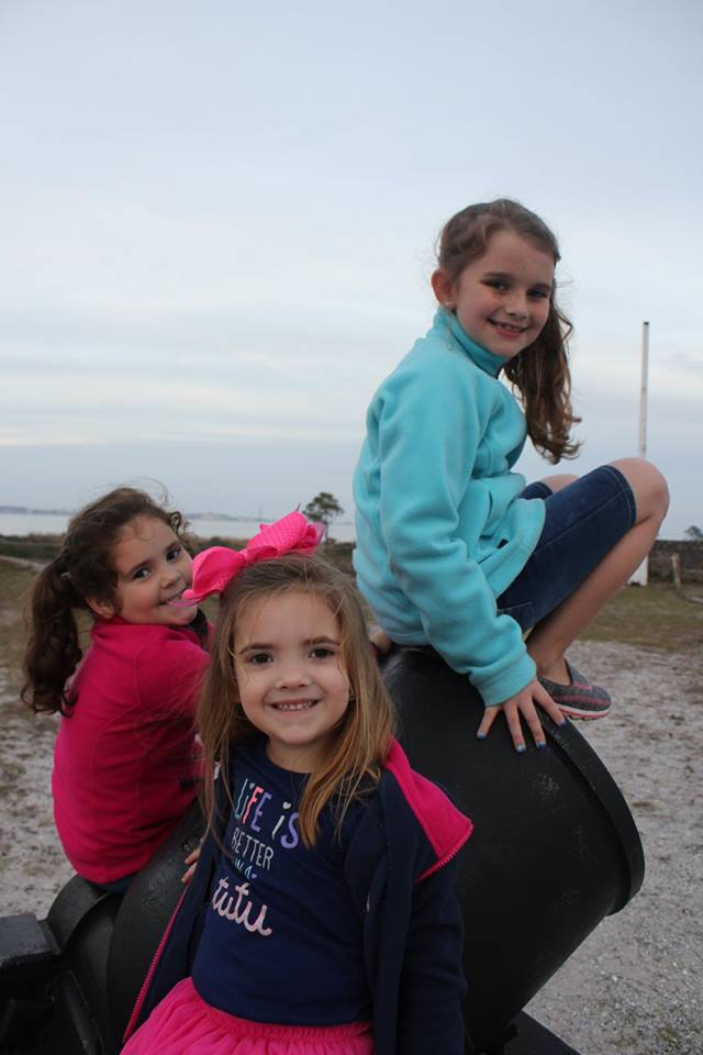 girls on cannon at Fort Pickens in Pensacola