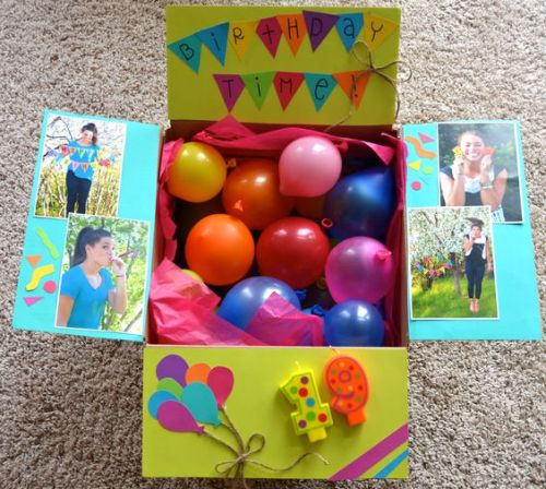 birthday care package that says birthday time and has number candles glued to flap