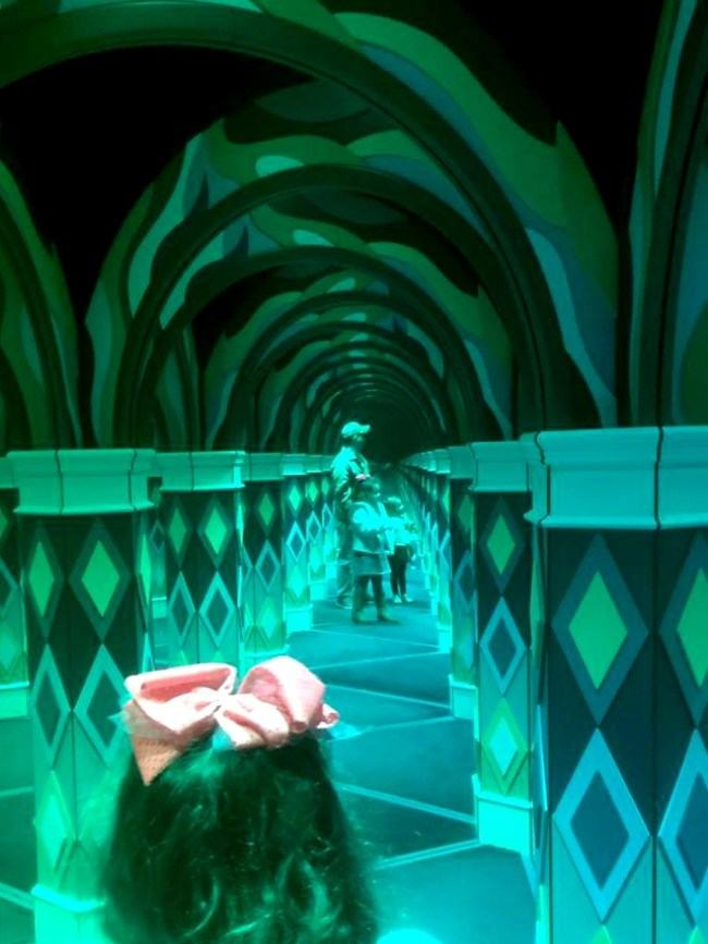 Family getting lost in the mirror maze at the Island in Pigeon Forge.