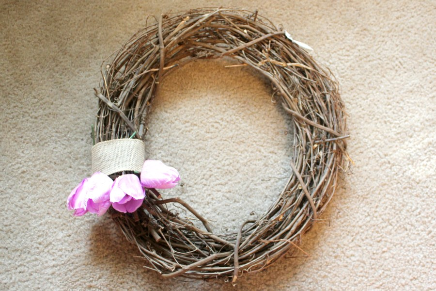 how to make a spring wreath - start placing tulips at the bottom of the ribbon