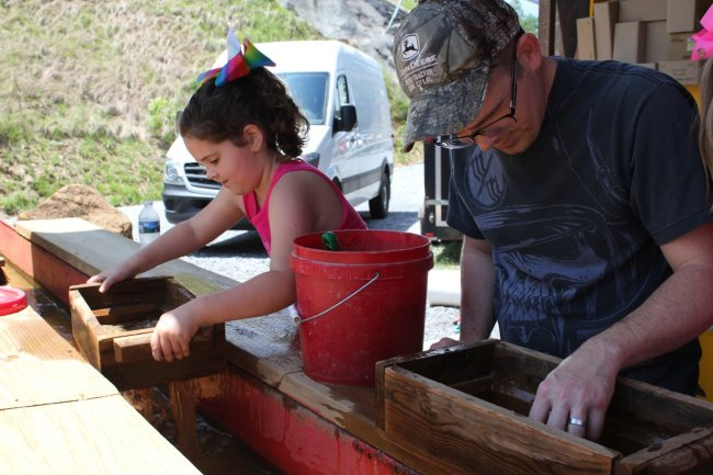 Girl and her dad mining for gems during a weekend in Pigeon Forge, Tennessee.