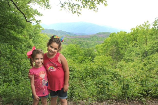 girls posing at overlook in the Smoky Mountain National Park in Pigeon Forge, Tennessee
