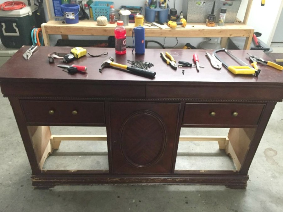 The first step in this dresser refurbish was to remove the drawers and damaged pieces.