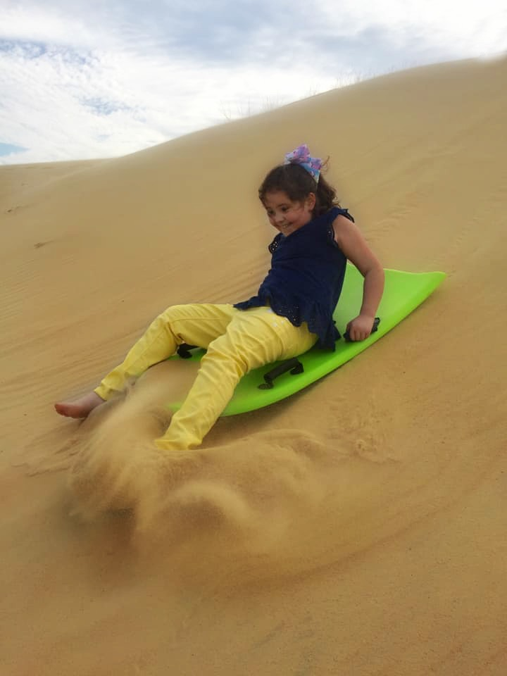 Sand sledding at Jockey's Ridge was the most fun we had in the Outer Banks!   Finding Mandee