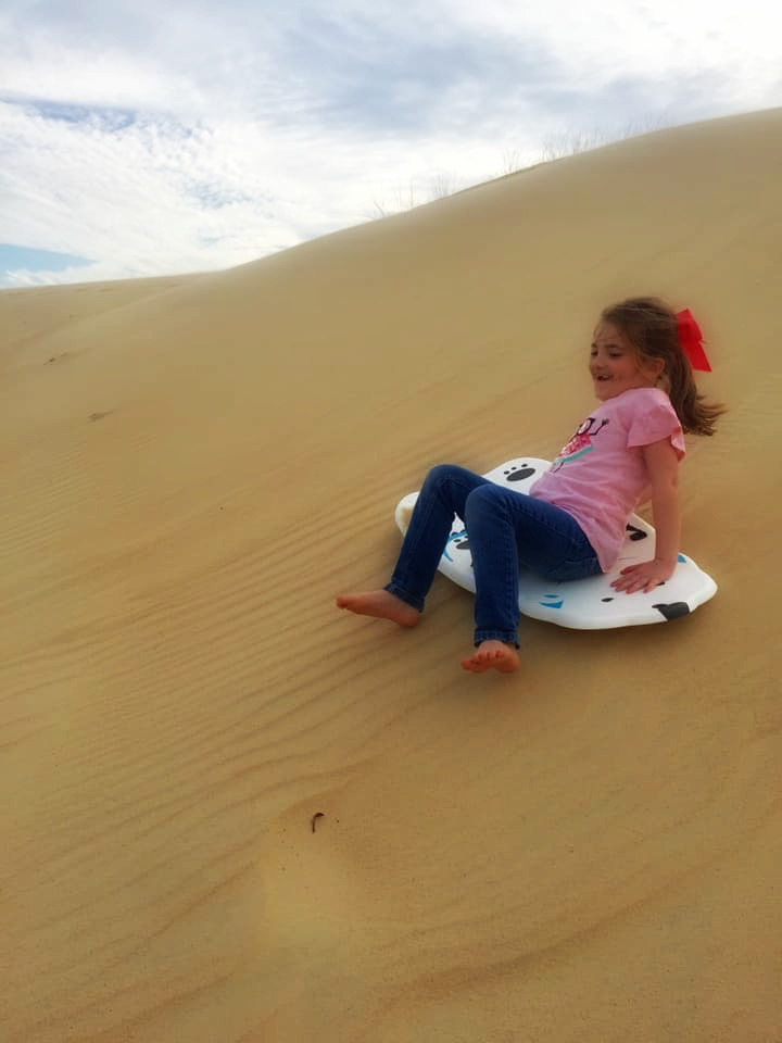 Dune sledding at Jockey's Ridge State Park was our favorite part of our trip to the Outer Banks.   Finding Mandee