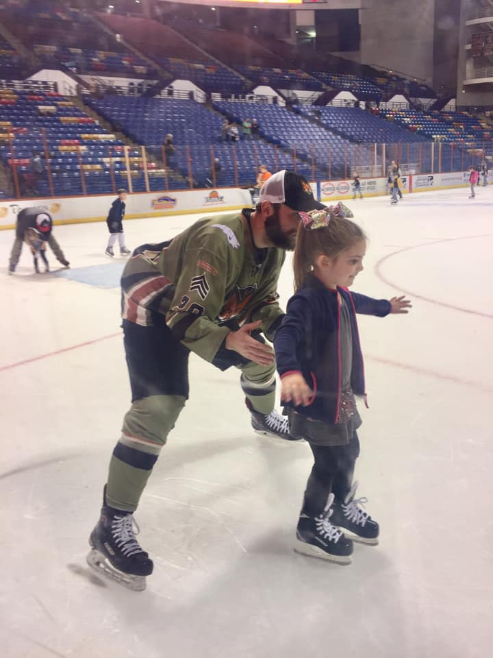 Girl skating with the players after the Marksmen Hockey Game in Fayetteville, NC.
