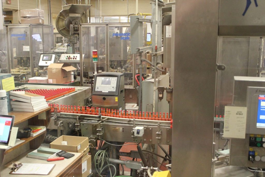 The bottling process at the Tobasco Factory.