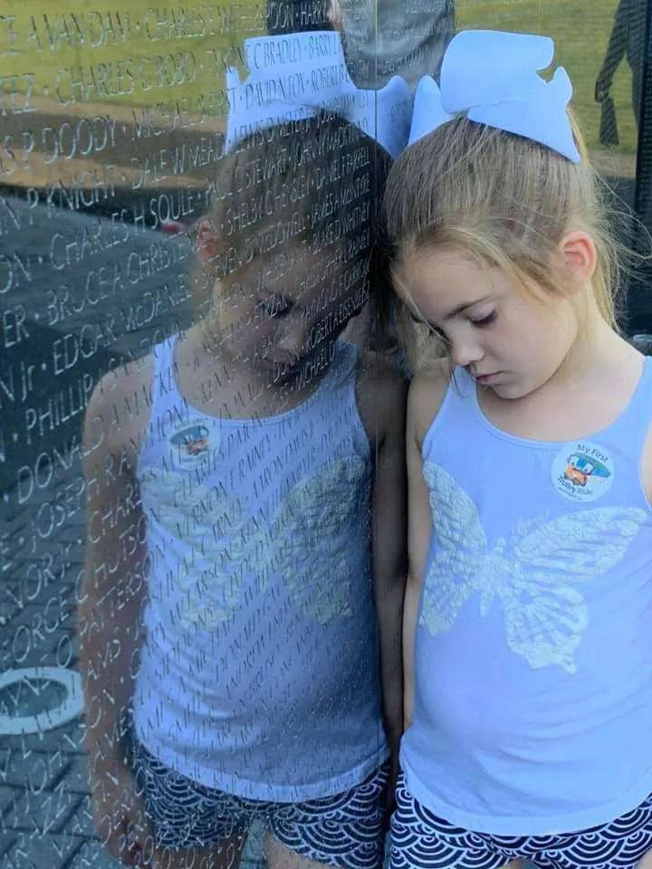 Little girl at the Vietnam Wall.