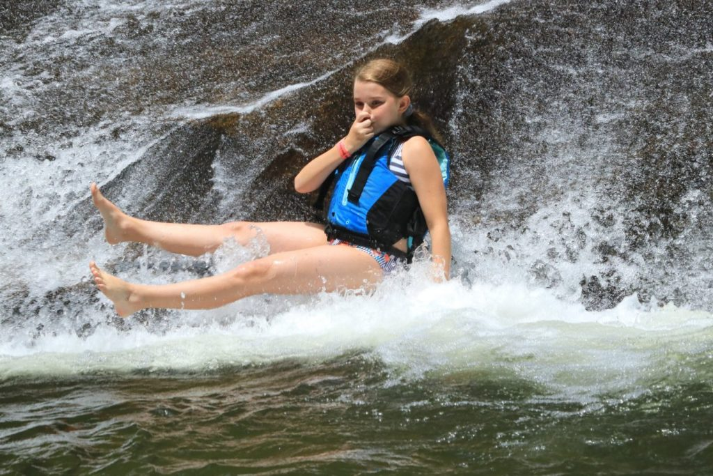 Taking the plunge into the pool at the bottom of Sliding Rock in North Carolina.