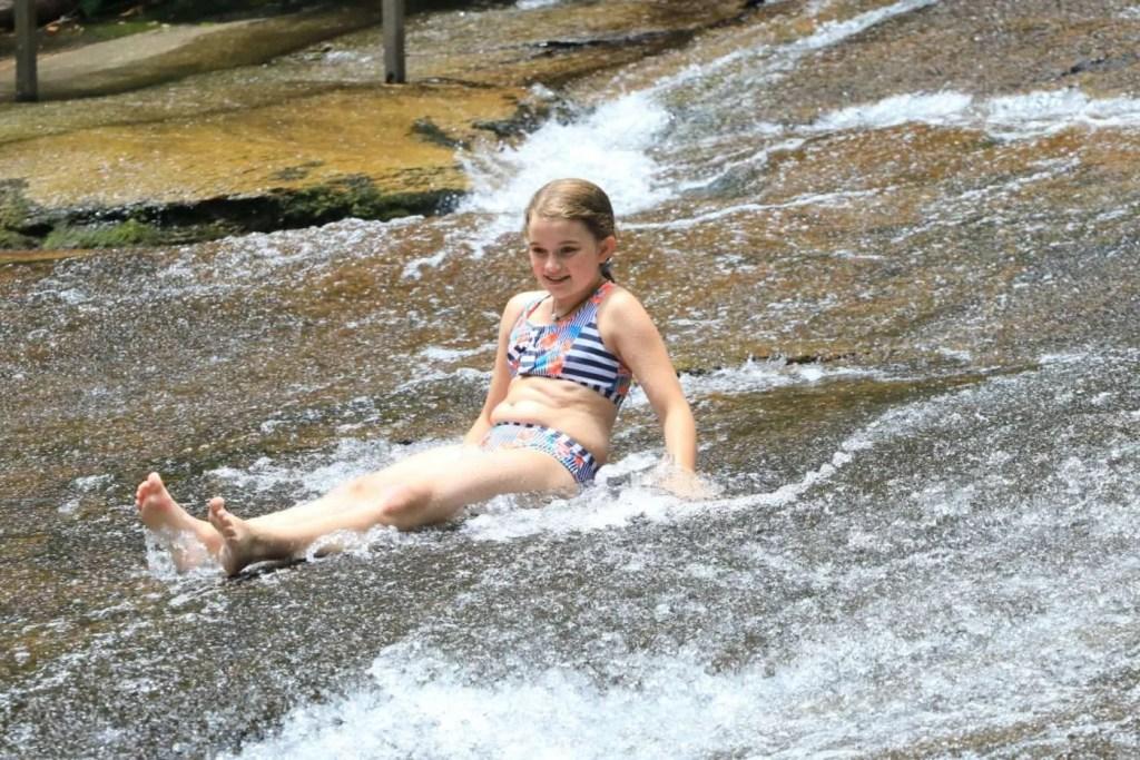 Going down Sliding Rock in North Carolina.