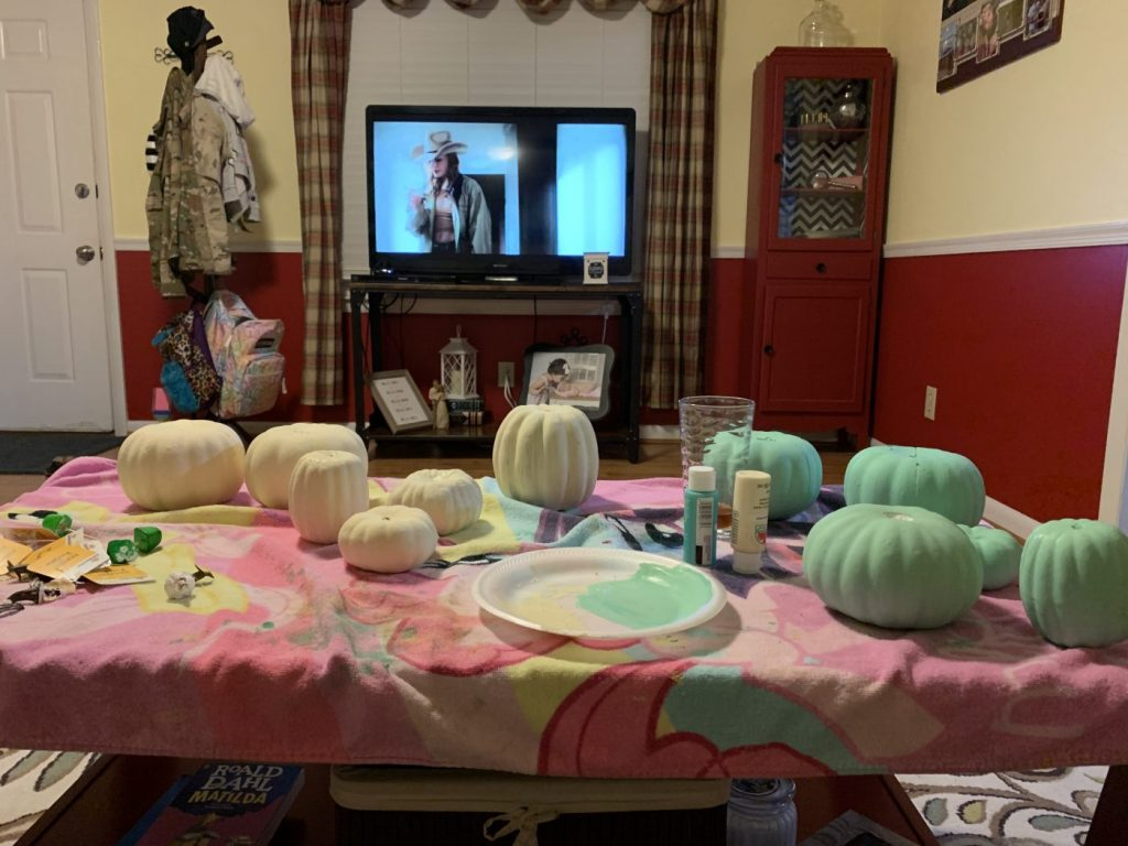 Making DIY farmhouse pumpkins for my mantel.