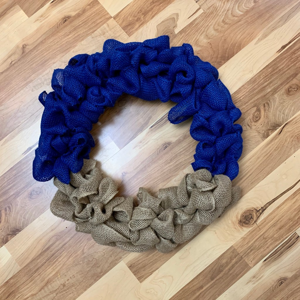 Add the blue burlap to the wreath form.