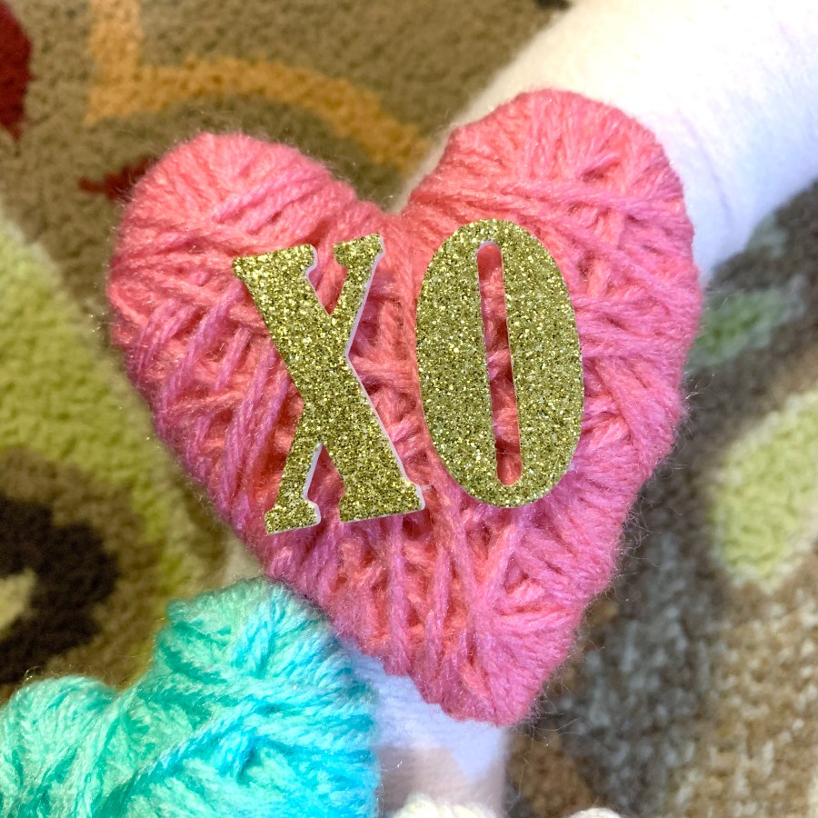 Glitter letters added to the Valentine's Day wreath.