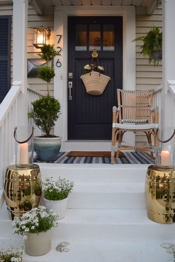 This small porch is big on style with it's navy, white, and gold accents.