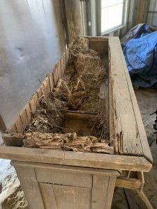 Top view of the cabinet before removing the rat nests and rotten wood.