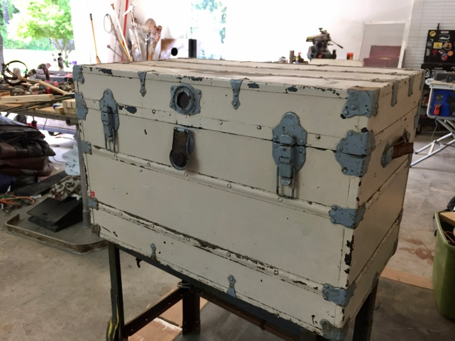 The before picture of the vintage trunk before we began refurbishing it.