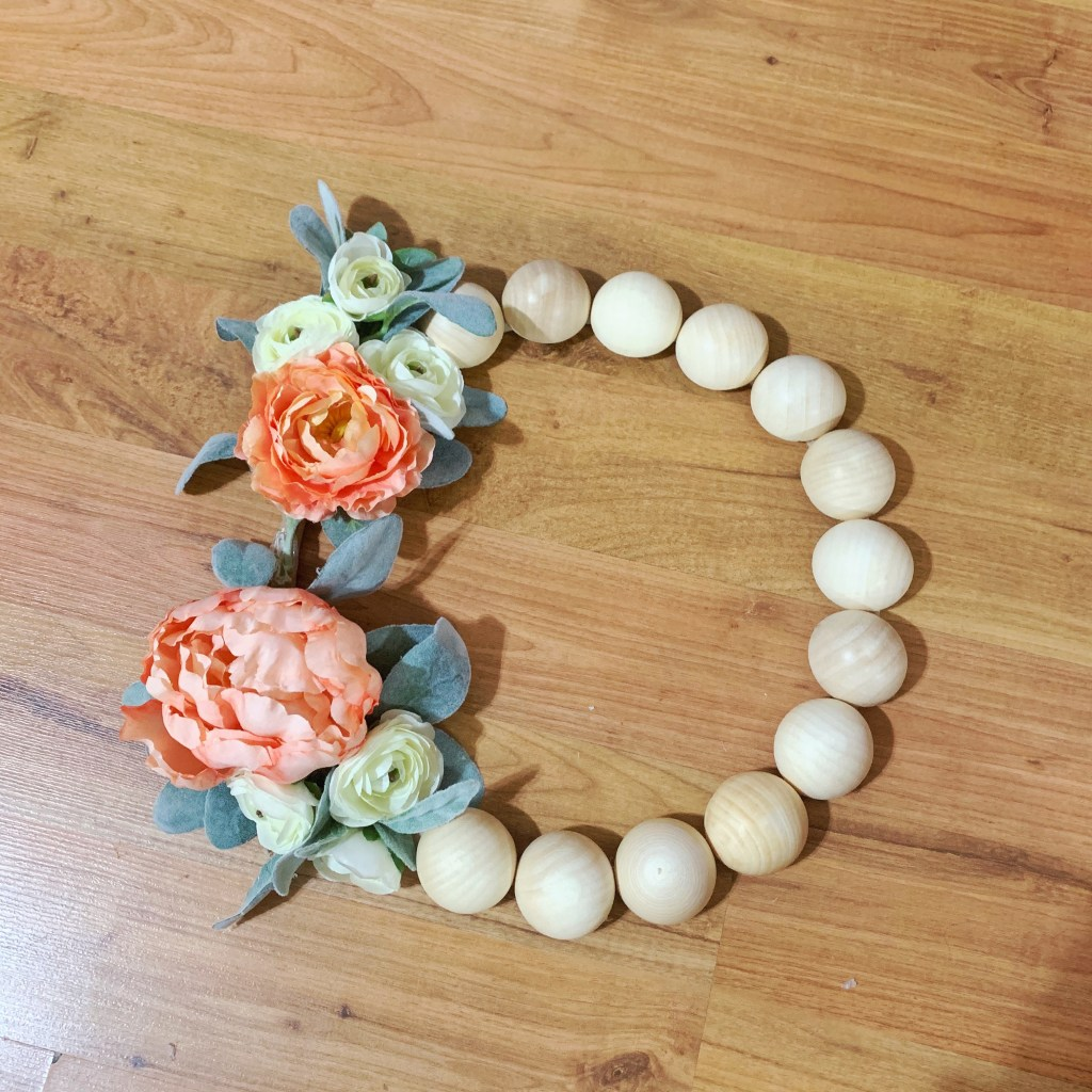 Step 4: Add flowers to your DIY wood bead wreath.