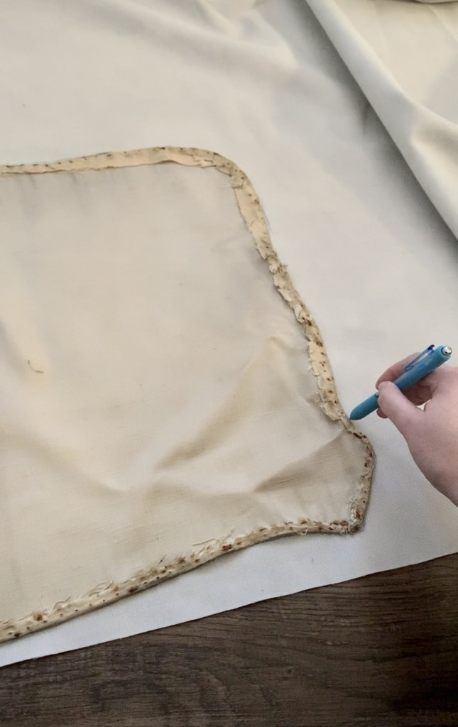 Trace the old fabric from the antique bed onto the new fabric.