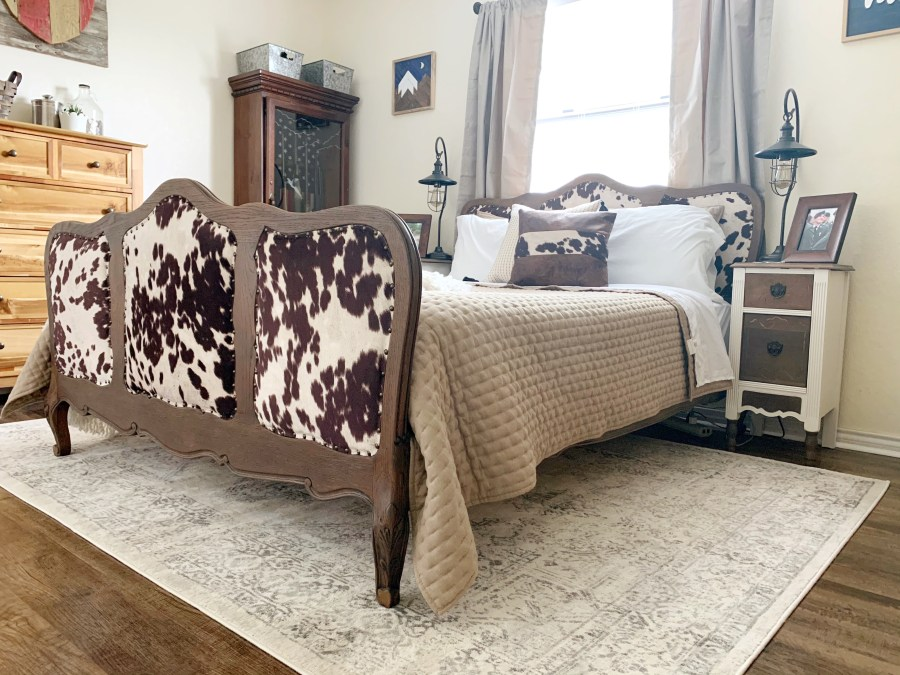 The refurbished antique bed with cow hide upholstery.