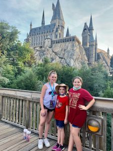 Girls in front of the Hogwarts castle at Islands of Adventure.