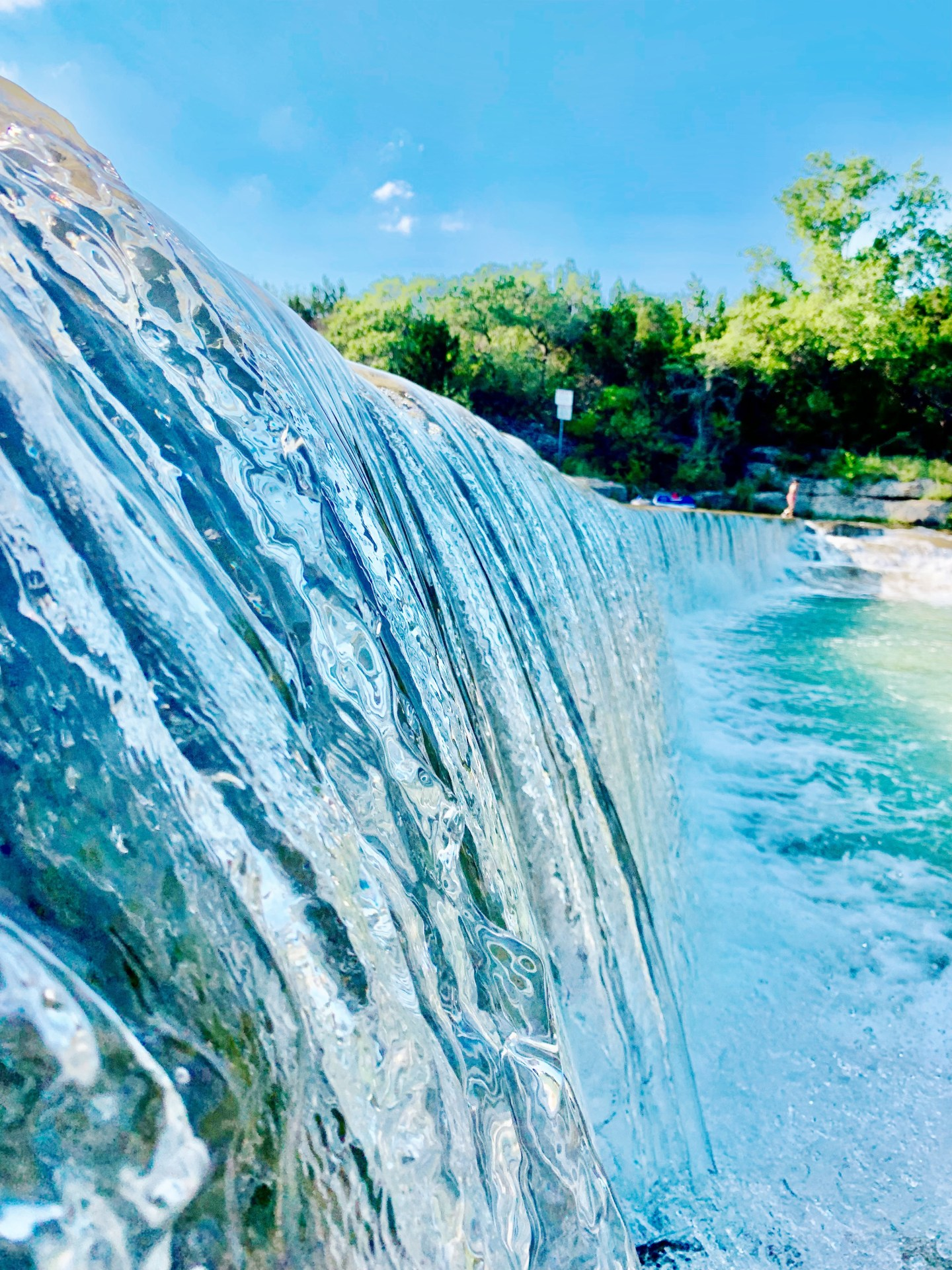 Water flowing over the dam at Blue Hole Park in Georgetown, Texas.