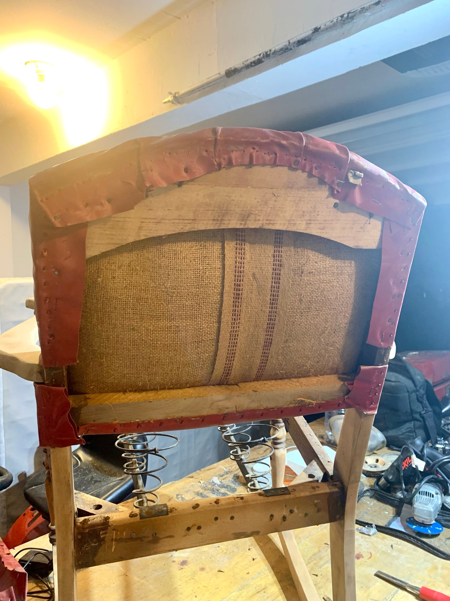 Burlap backing in an antique rocking chair.