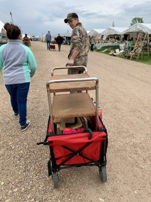 Using a wagon to pull our purchases at the Round Top Antique Show.