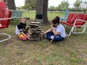 Girls playing a Jenga yard game at the Junk Gypsy store.