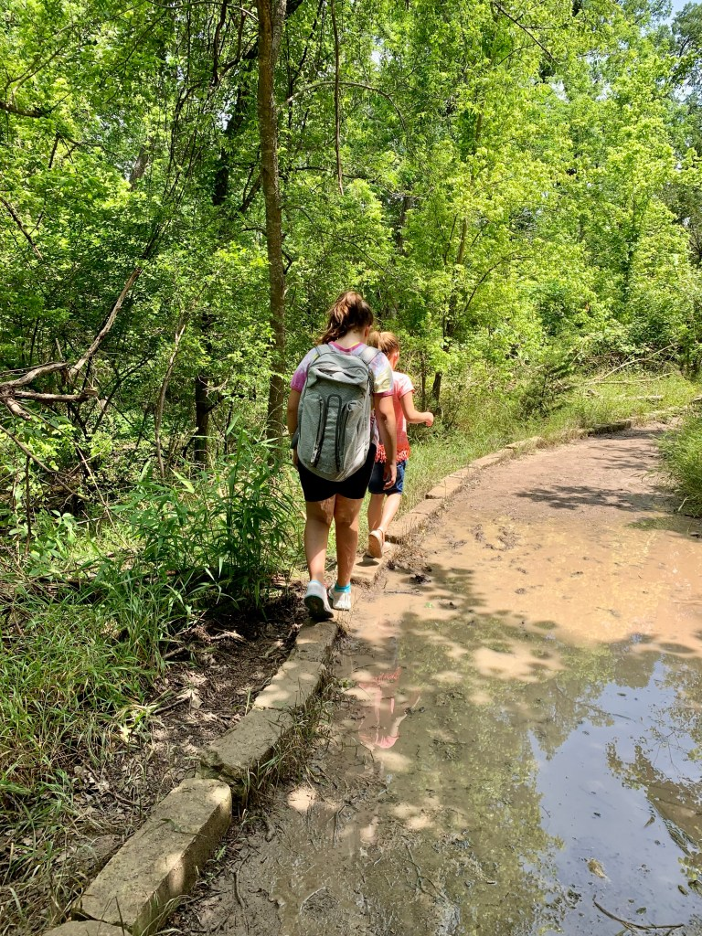 Avoiding the mud puddles on our hike in Belton, TX.