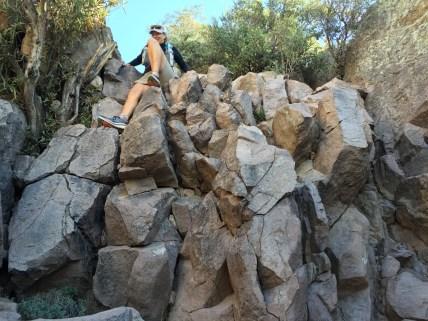 Deb climbing down the cliff.