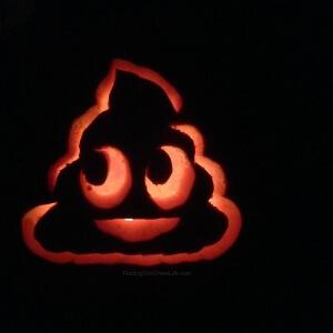 pumpkin carved with poop emoji