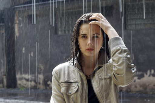 young woman in rain