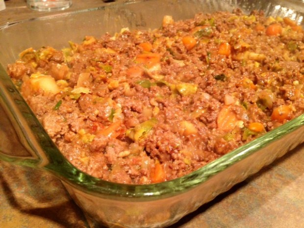shepherds pie with carrot goat cheese mash filling in pan