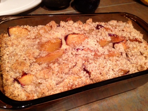 fluffy plum cake with almond crumble baked