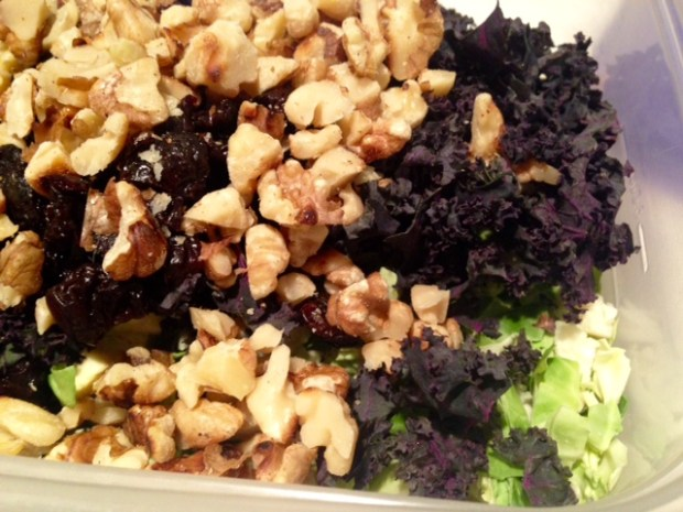 shredded brussels sprout salad with maple-cider vinaigrette walnuts