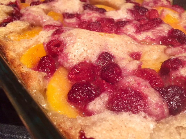 This jammy peach raspberry cobbler is one of those perfect desserts for summer parties