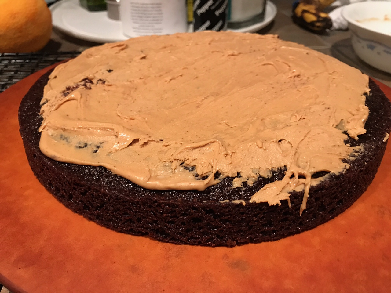 filling the chocolate stout cake with peanut butter frosting