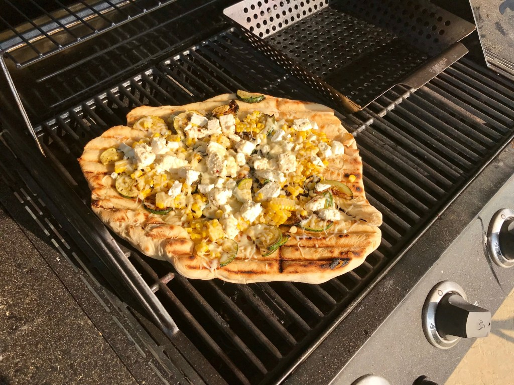 Grilled zucchini pizza with grilled corn & marinated feta