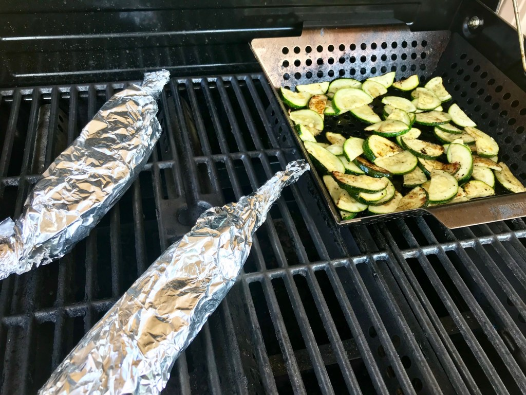 Grilled zucchini and grilled corn on the cob