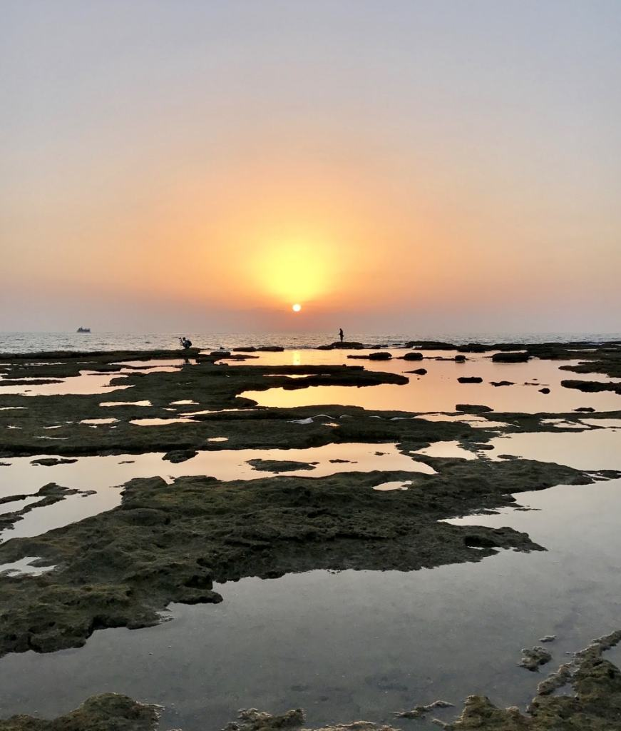a stunning sunset in akko after exploring israeli food