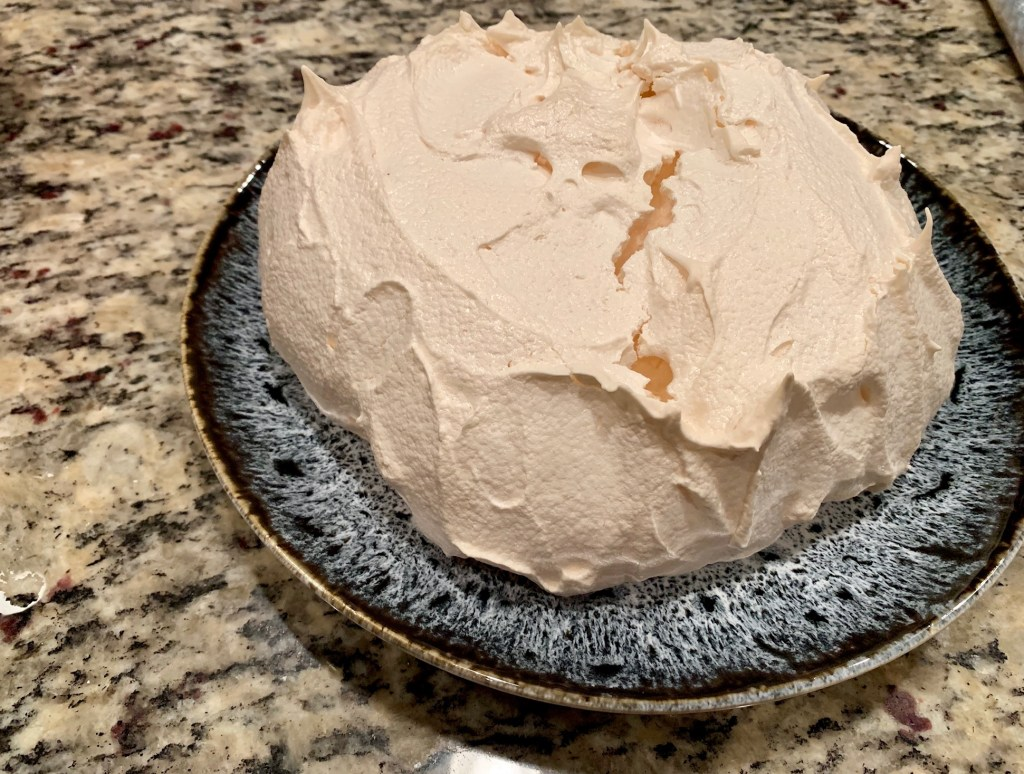 easy almond pavlova recipe, baked and cooled