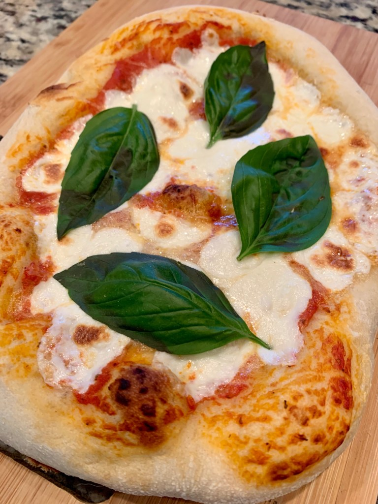 Easy Grilled Margherita Pizza | A traditional margherita pizza is a thing of beauty, and this recipe makes it super simple. With only a few ingredients, you can have hot, fresh pizza on any weeknight. An easy weeknight dinner, perfect grilling recipe, grilled pizza, how to make grilled pizza | finding time for cooking