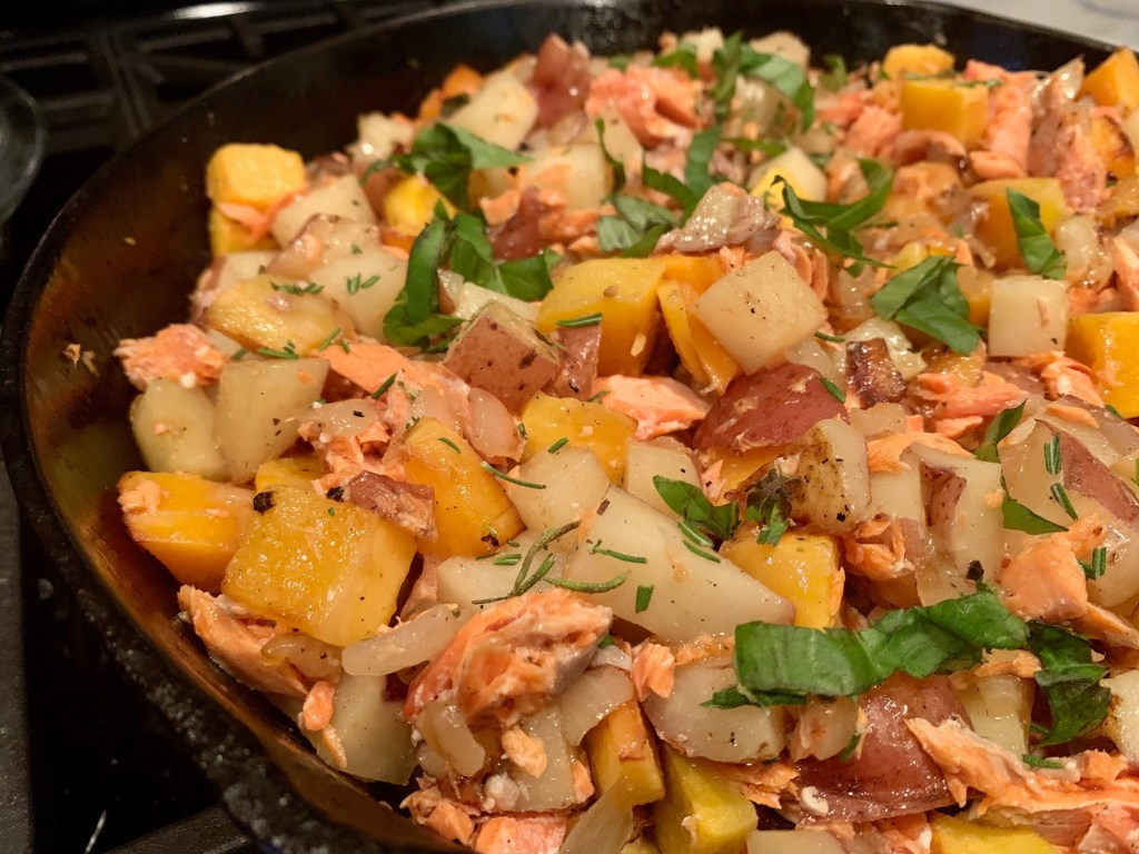 Easy, Healthy Salmon & Potato Hash with Fresh Herbs   This delicious hash is perfect if you're looking for how to use up leftover salmon, packed full of vegetables and protein, and can be a side dish or main. Amazing leftovers or breakfast for dinner as well. #breakfastfordinner #healthyrecipe #leftovers #salmon #breakfast