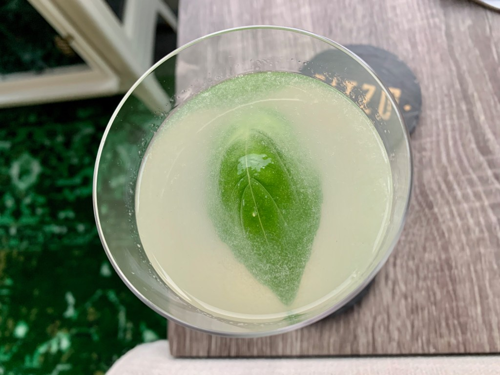 Basil Gin Gimlet Cocktail | This easy basil gin cocktail recipe is tart, herby, and refreshing. A twist on a gimlet cocktail made with gin, it's a great way to use up basil, perfect for late summer's abundance of basil. It only takes a couple ingredients and is an amazing easy cocktail recipe. Gin, lime, basil, and simple syrup! #cocktail #gimlet #basil
