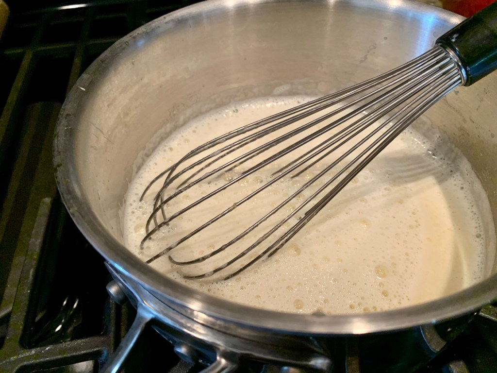 to make the salted honey pastry cream, slowly whisk the hot milk into the egg yolk mixture