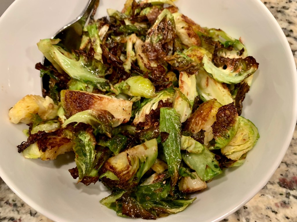 Crispy Roasted Brussels Sprouts with Balsamic-Honey Drizzle | These roasted brussels sprouts are totally addictive and super easy, perfect for any weeknight but also a fancy holiday dinner. You need these honey balsamic brussels sprouts in your life!