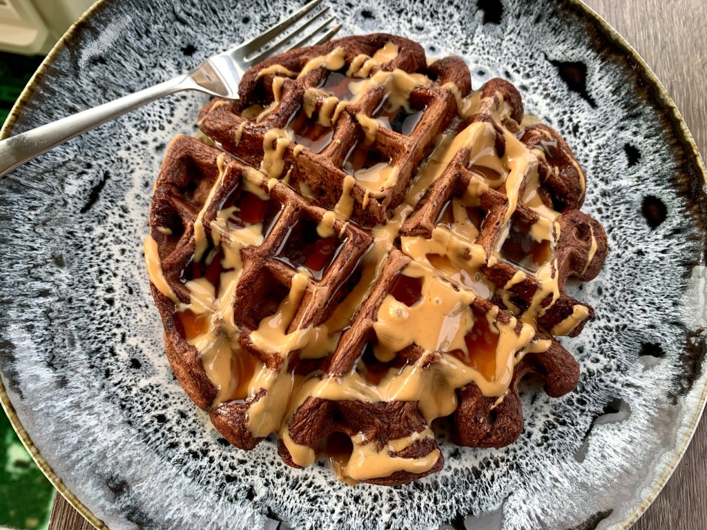Dark Chocolate Waffles...Bittersweet & Indulgent Brunch Recipe | I'm obsessed with these easy dark chocolate waffles, slathered in peanut butter and syrup. Not too sweet, they're perfect for brunch, a romantic occasion, a Valentine's brunch, or just because. #brunchrecipe #darkchocolate #waffles #breakfast