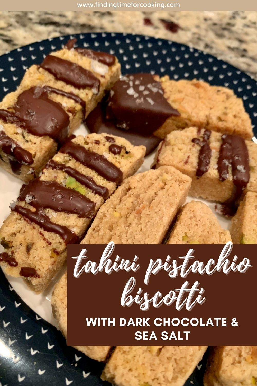 Tahini Pistachio Biscotti with Dark Chocolate & Sea Salt | These super unique tahini biscotti are dipped in dark chocolate and sprinkled with sea salt...a perfect treat with coffee or tea! Easy biscotti recipe you'll love. #biscotti #tahini #darkchocolate