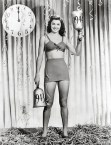 Esther Williams. Holding really giant bells.